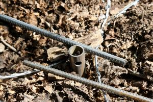 Screw pile and barbed wire fittings