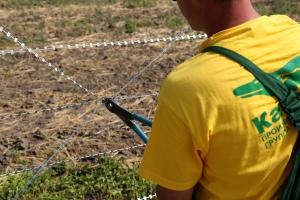 Installation of brackets on Concertina barbed wire